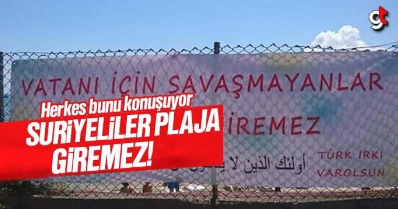 'Bu plaja vatanı için savaşmayanlar giremez' pankartı
