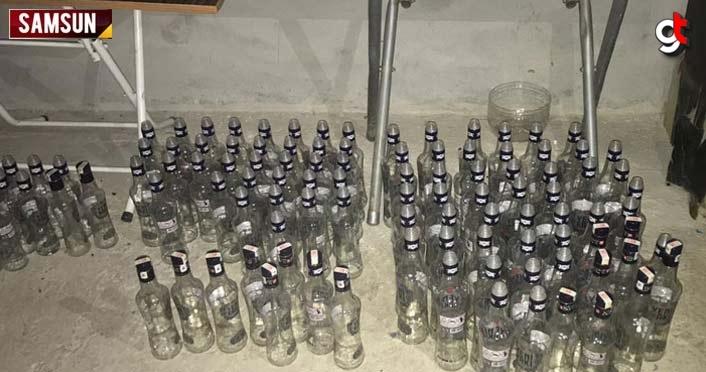 Samsun'da imalathaneye dönüştürülen iş yerinde 50 litre sahte içki ele geçirildi