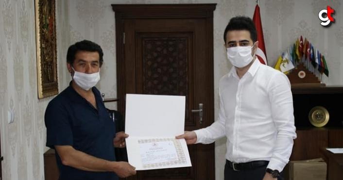 Güce Kaymakamı Orhan'dan Vefa Sosyal Destek Grubu çalışanlarına başarı belgesi
