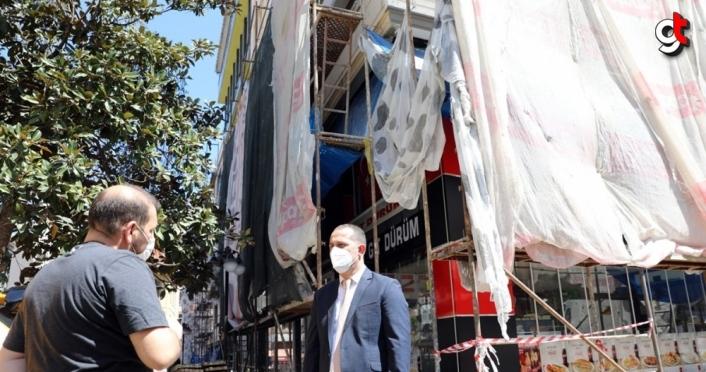 Akçaabat'ta bazı caddelerdeki binaların cephe düzenleme çalışmalarına başlandı