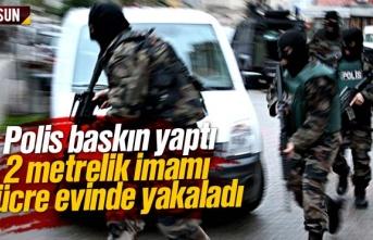 Polis baskın yaptı, 2 metrelik imamı hücre evinde...